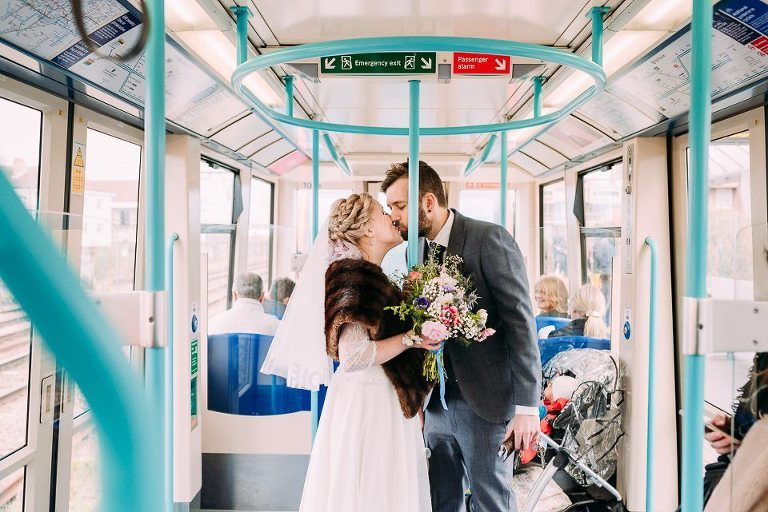wedding portrait of bride and groom kissing in tube underground
