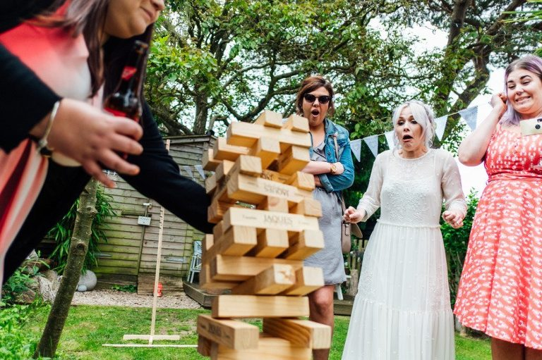 bride playing giant jenga at a back garden wedding in kent